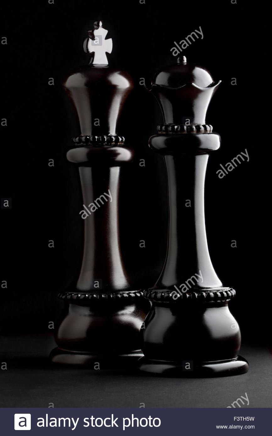Low key silhouette of classic black chess pieces including ...