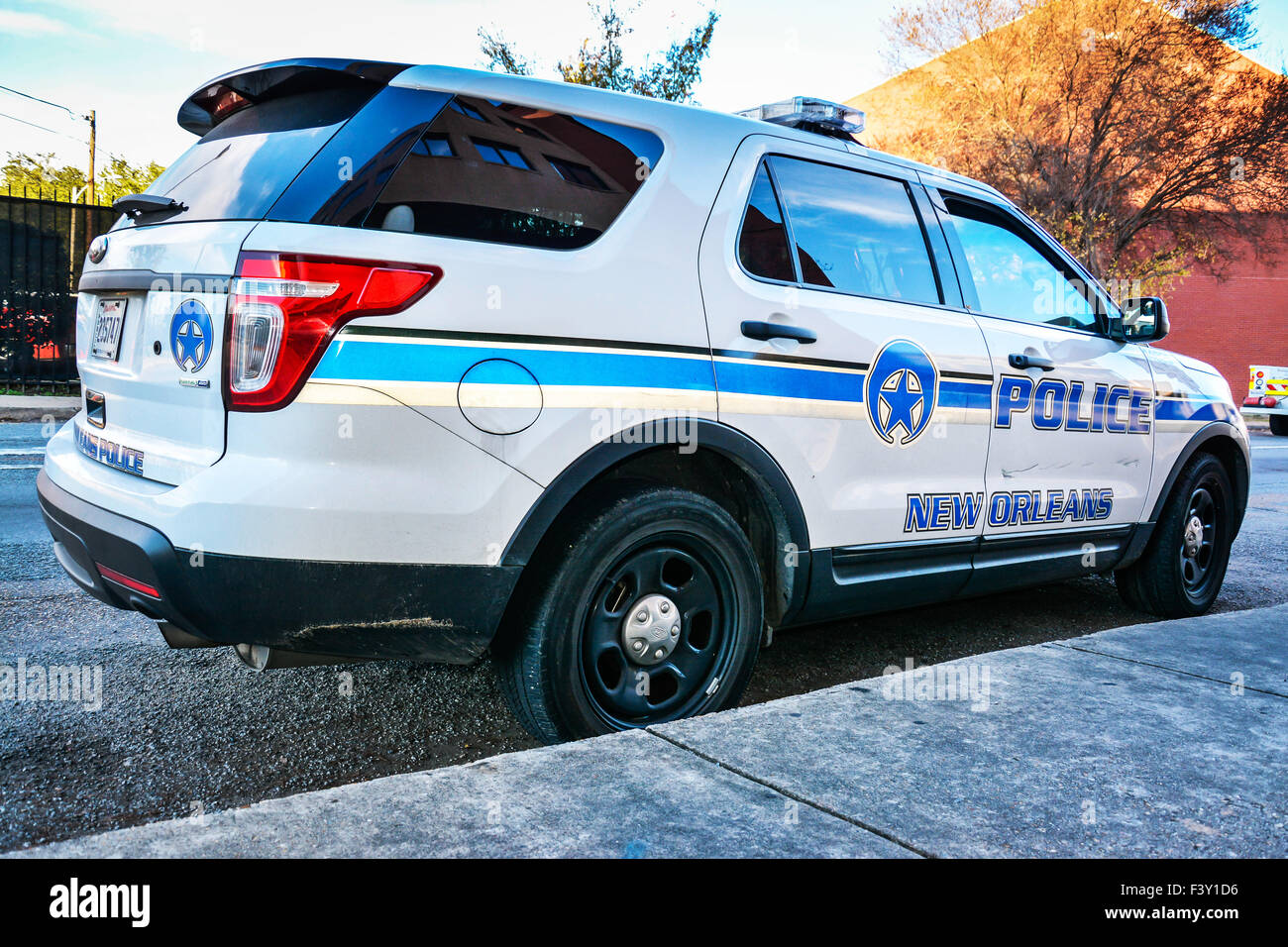 A blue and white parked police car or cruiser in new for Police orleans