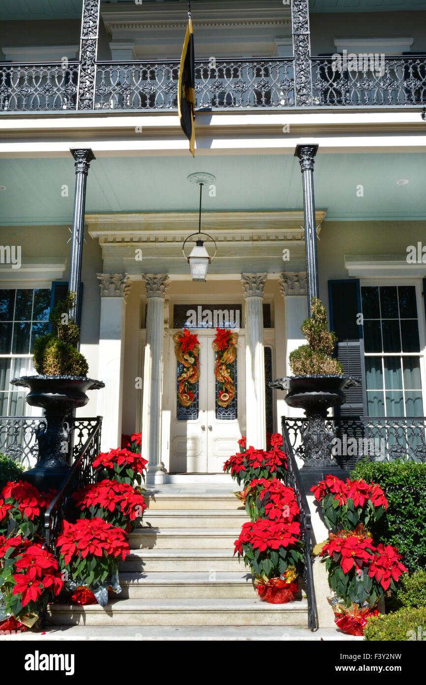 Red Poinsettias Line The Stairs As Holiday Decorations To Porch U0026 Entrance  To Mansion In The Garden District, New Orleans, LA