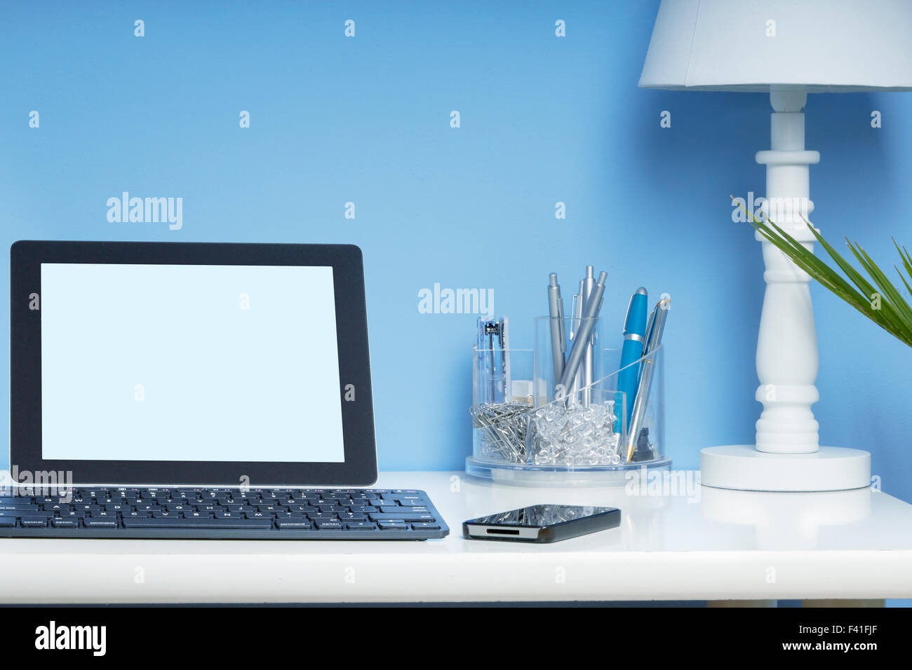 home office interior set up with a blank tablet screen to add copy add home office