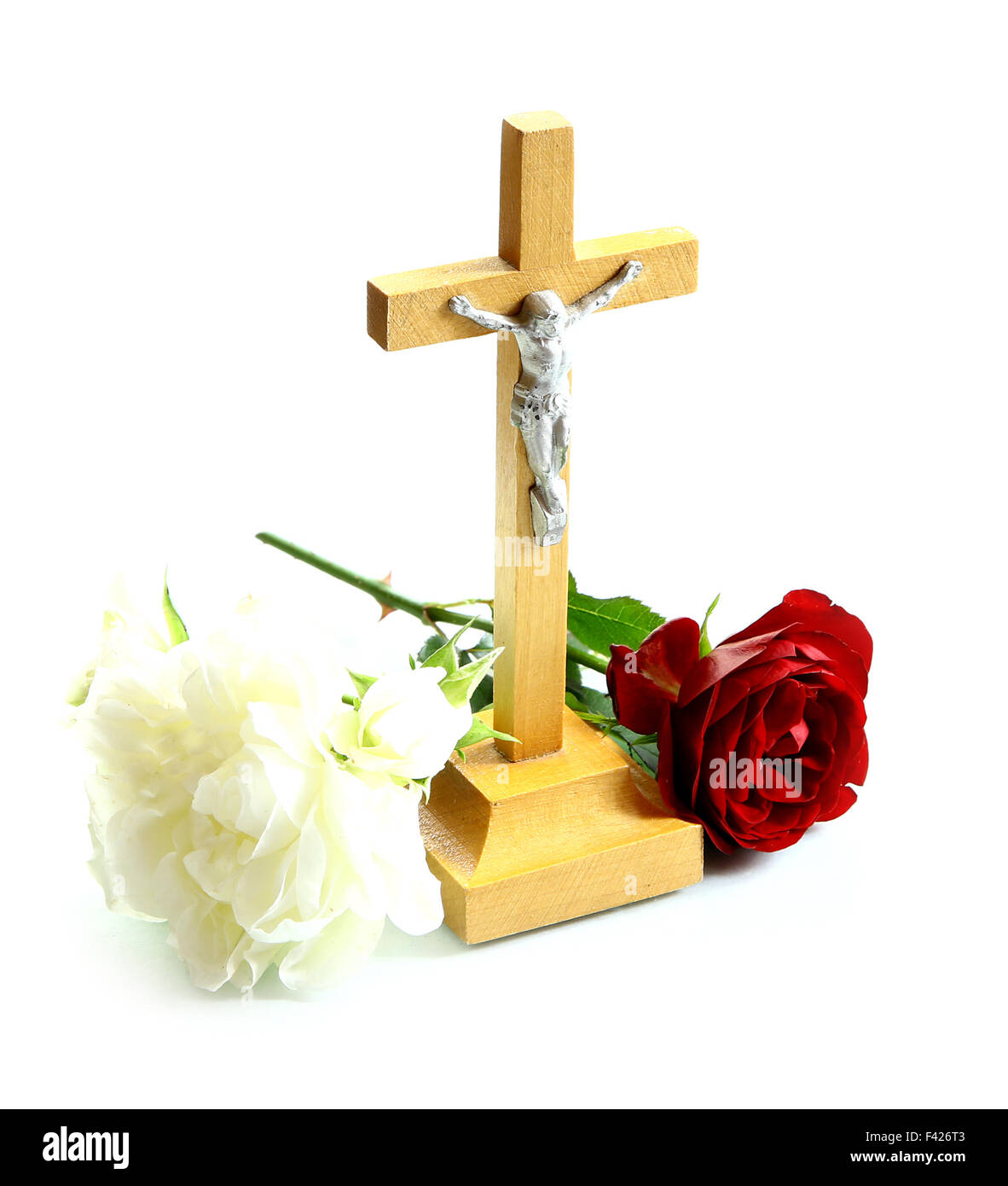 very simple wooden holy crucifix jesus christ on cross white stock