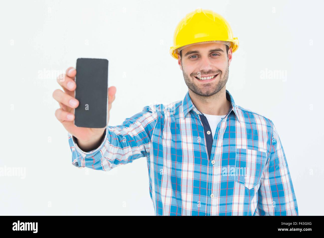 happy construction worker showing smart phone stock photo royalty happy construction worker showing smart phone