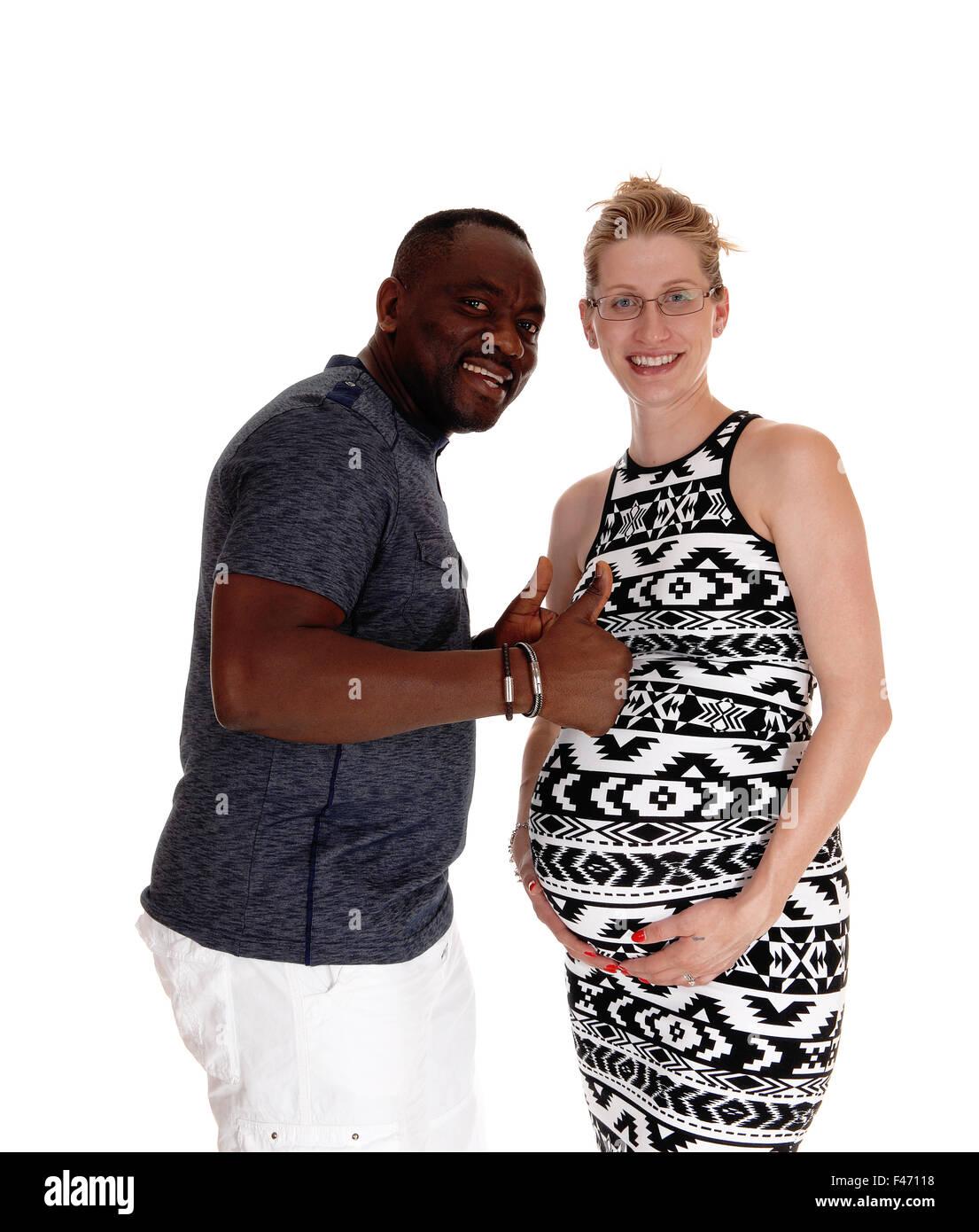 Happy white woman pregnant, black man Stock Photo, Royalty