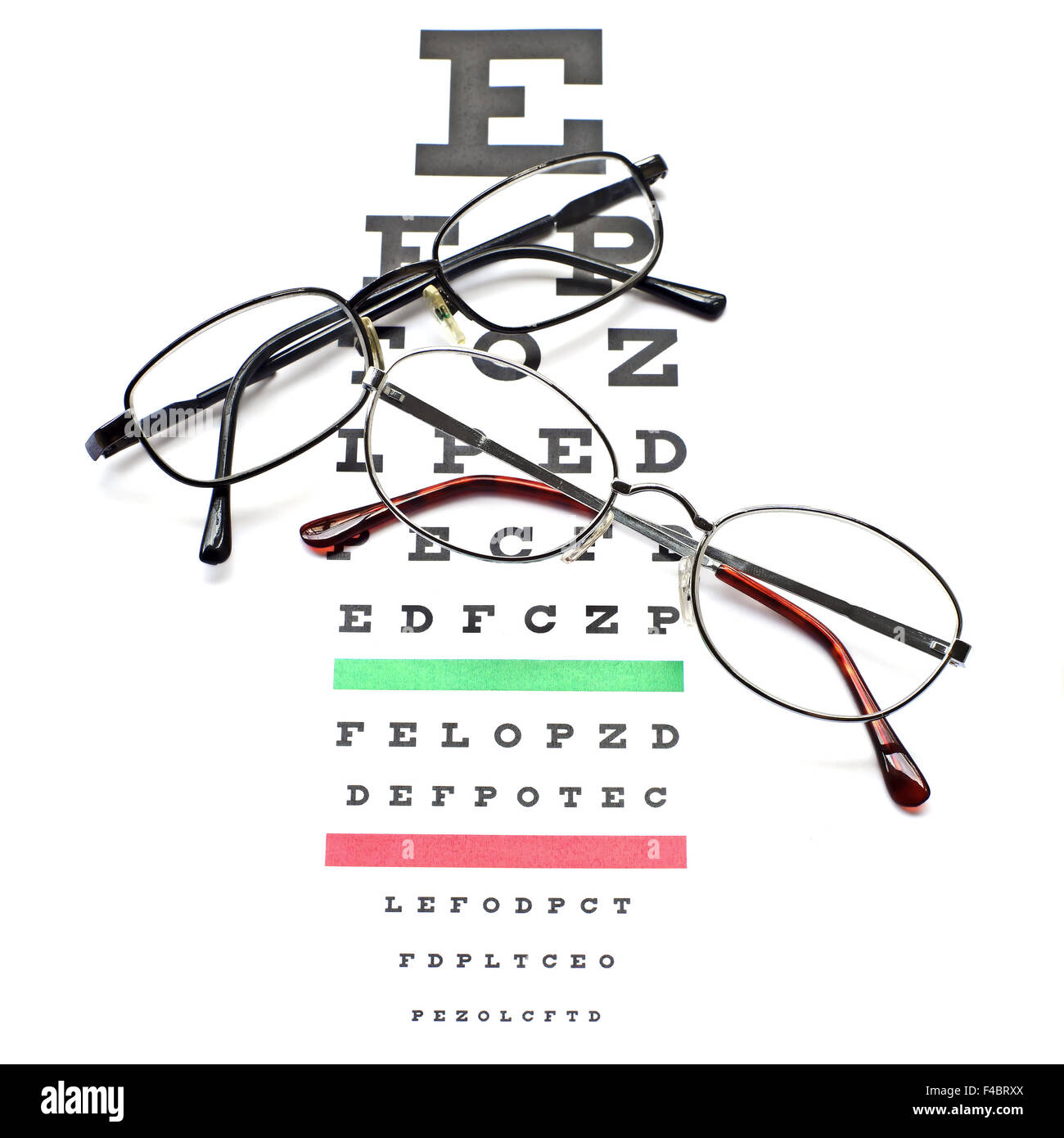 Glasses on snellen eye sight chart test background stock photo glasses on snellen eye sight chart test background nvjuhfo Images