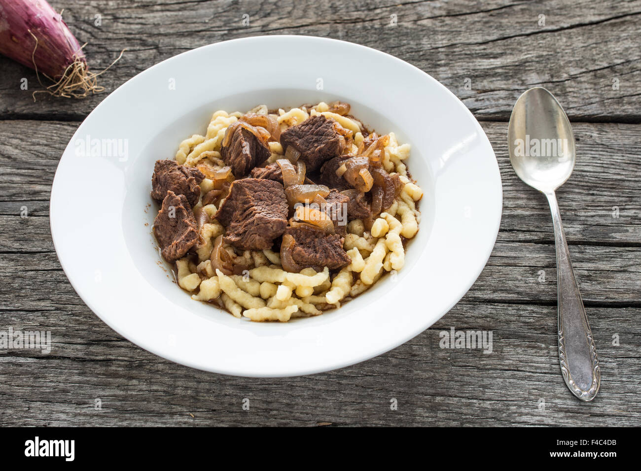 Stock Photo White Plate Of Beef Goulash With Swabian Noodles
