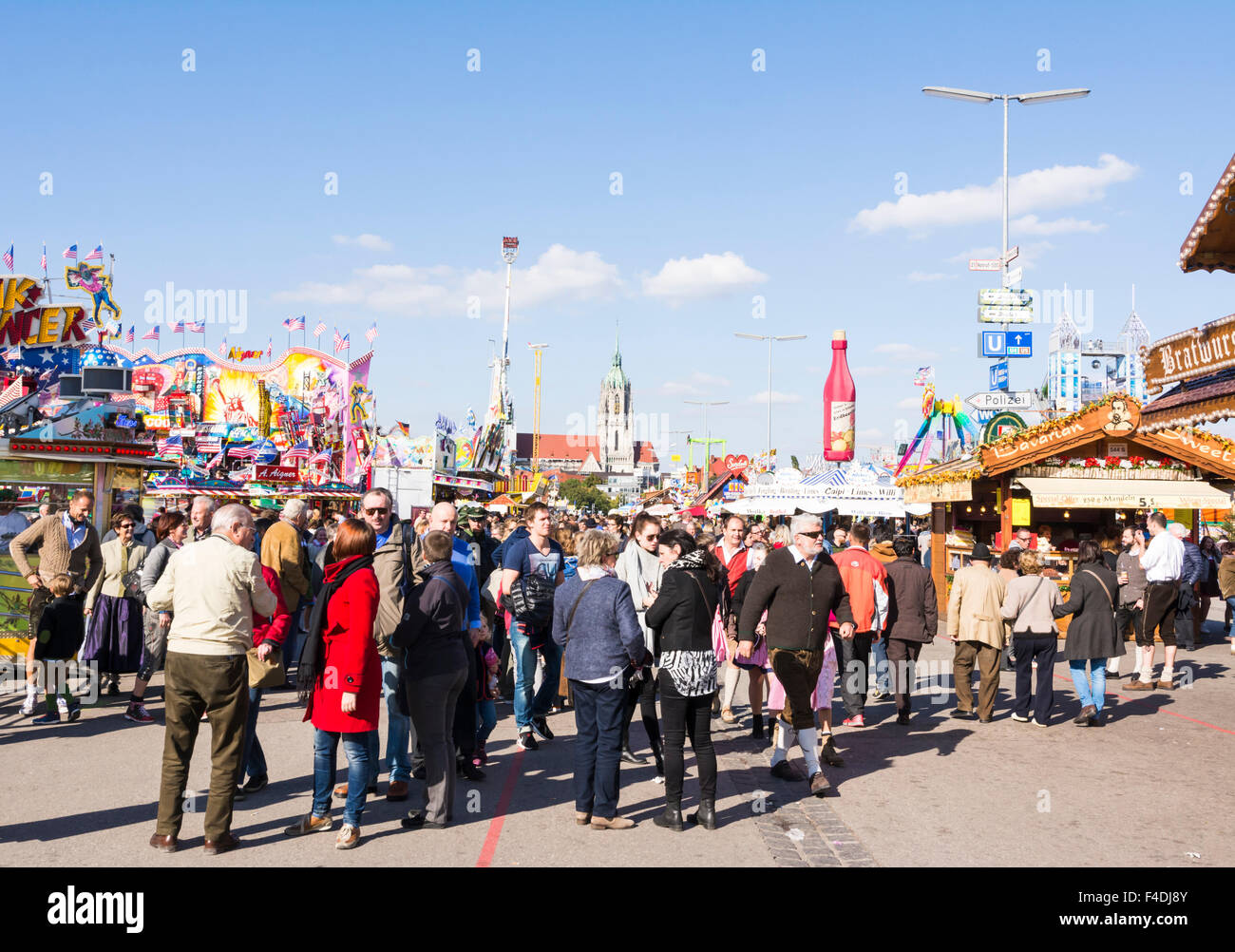 MUNICH GERMANY - SEPTEMBER 30 People in front of the beer tents on the Oktoberfest in Munich Germany on September 30 2015 & MUNICH GERMANY - SEPTEMBER 30: People in front of the beer tents ...