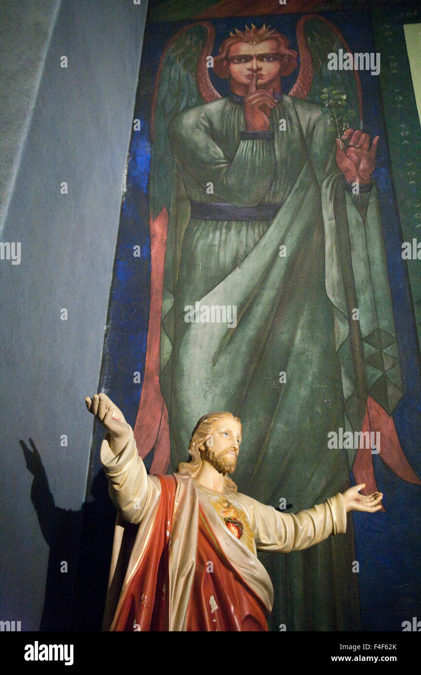 detail of wall mural created by croatian artist maxo vanka of wall mural prudence created by croatian artist maxo vanka above the statue of christ