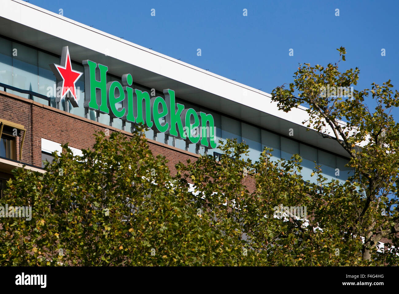 A logo sign outside of the headquarters of heineken nv in amsterdam stock photo royalty free - Heineken amsterdam head office ...