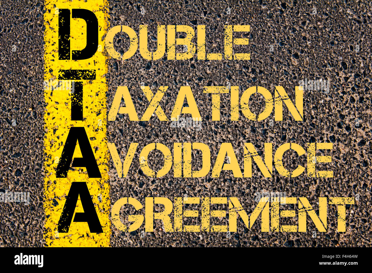 Concept image of business acronym dtaa as double taxation avoidance concept image of business acronym dtaa as double taxation avoidance agreement written over road marking yellow platinumwayz