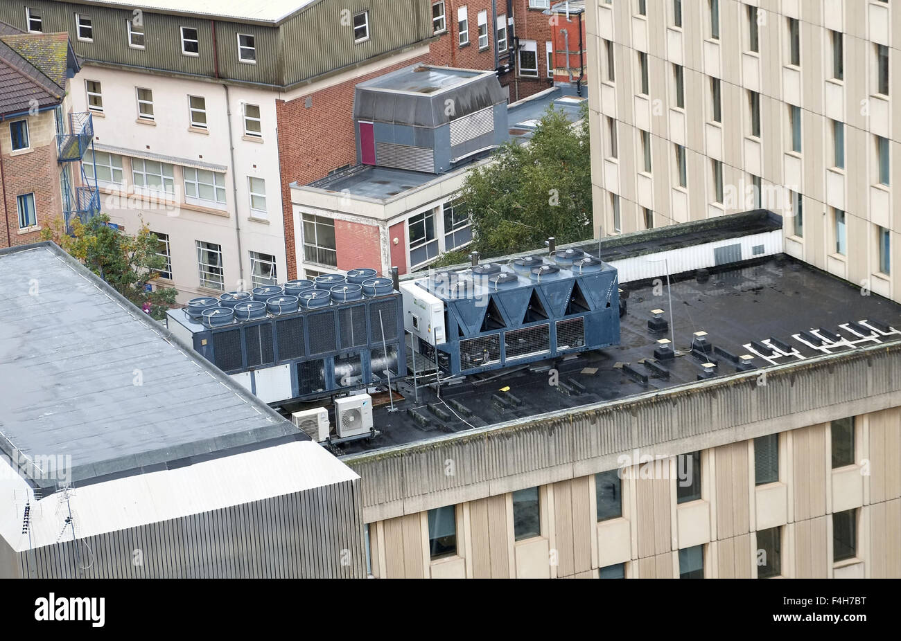 Roof Air Handlers : Office block with old style air conditioning units