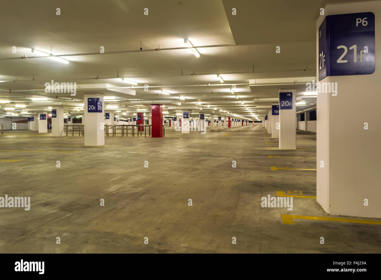 Empty Parking Lot Inside Commercial Building Stock Photo