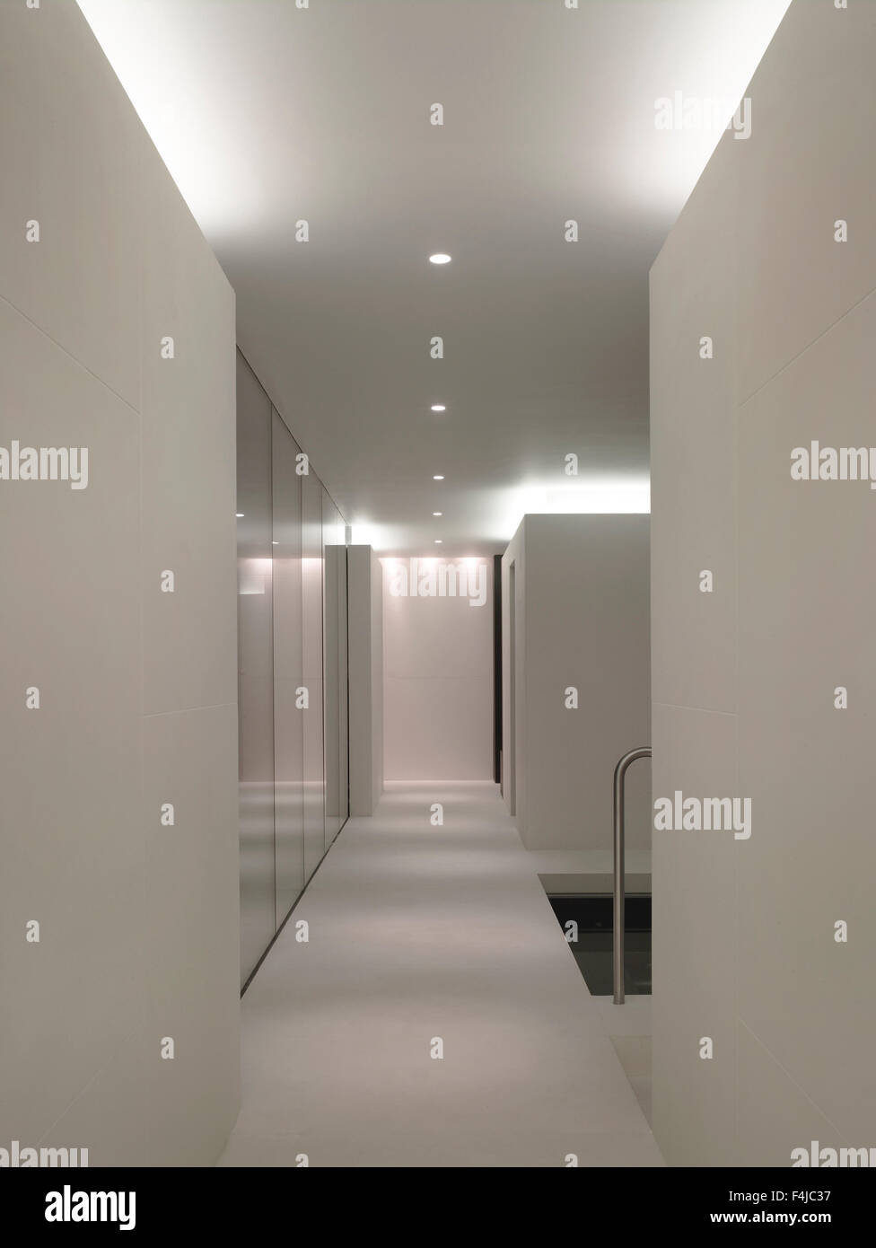 White interior with glass and stone partitioning Underground Spa