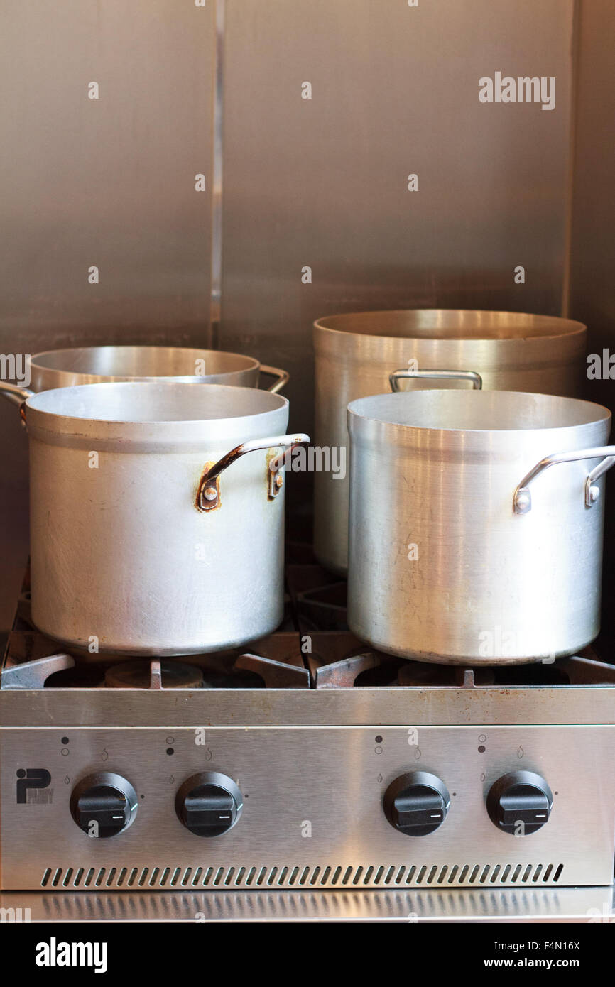 Restaurant Kitchen Gas Stove large pot on a stainless steel gas stove in a restaurant kitchen