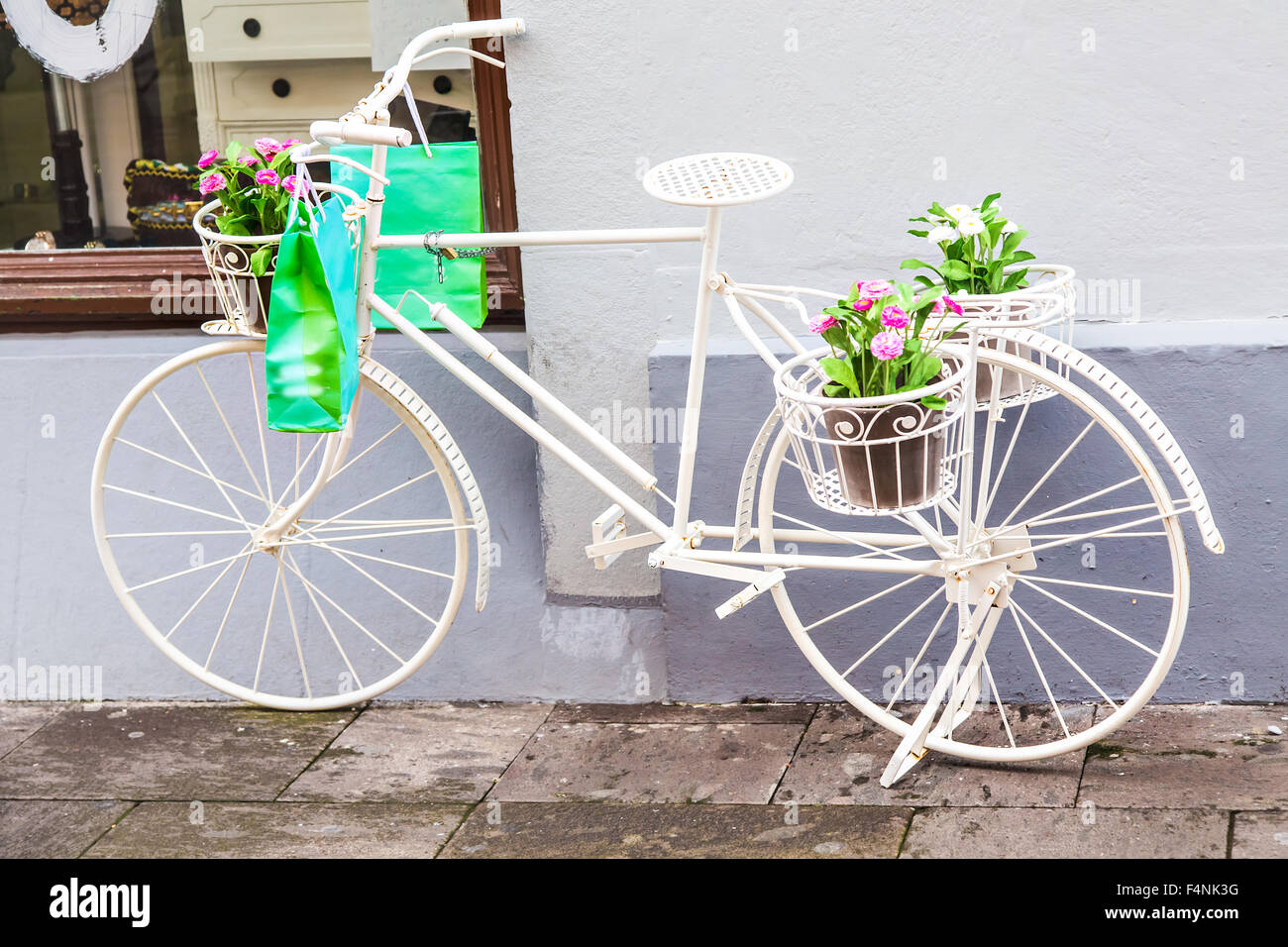 bicycle decorative in front of the flower shop. bicycle decorative in front of the flower shop Stock Photo