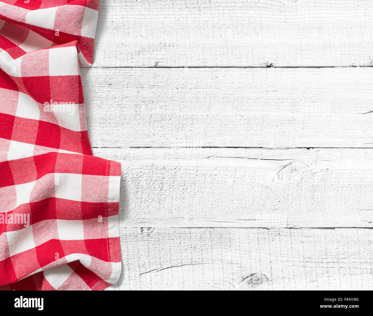 White wood table texture - Stock Photo Checked Picnic Tablecloth On White Wood Table Background