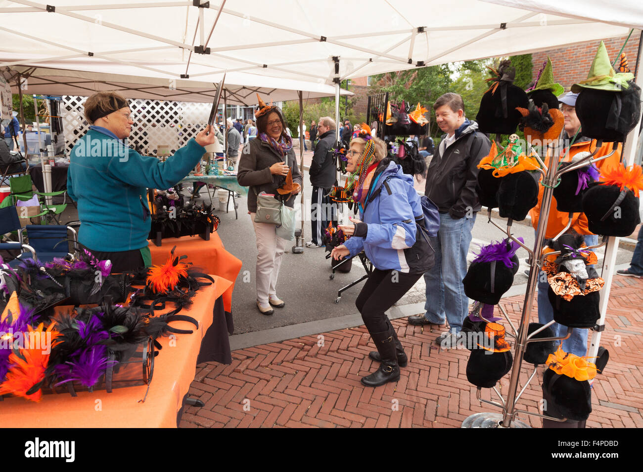 Tourists buying halloween goods at a market stall, Salem Stock ...