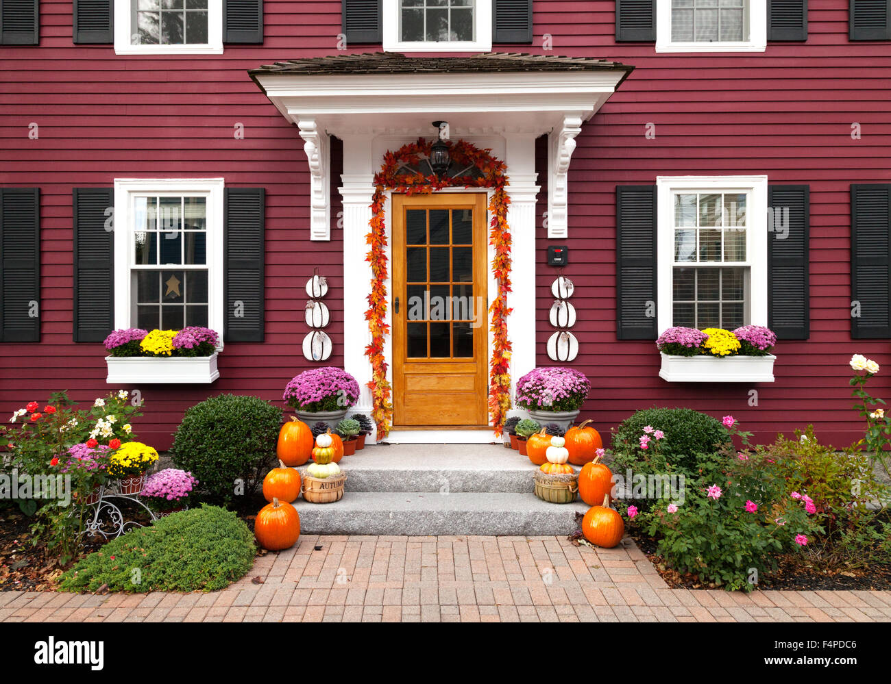 The front entrance and door of a house decorated for Halloween ...