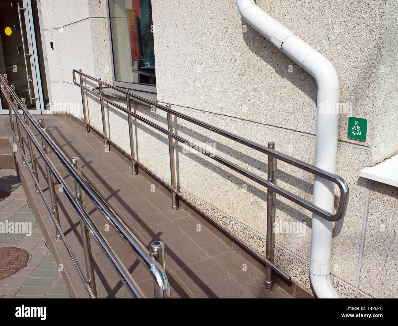 Ramp For Physically Challenged With Metal Railing At The