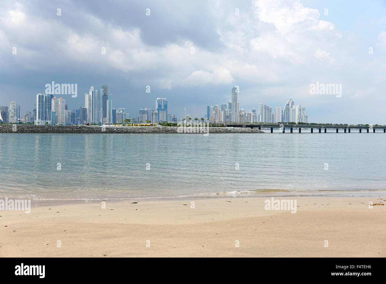 Beach Sand In Foreground With The New Highway Over Bay And Panama City Skyscrapers Background Central America