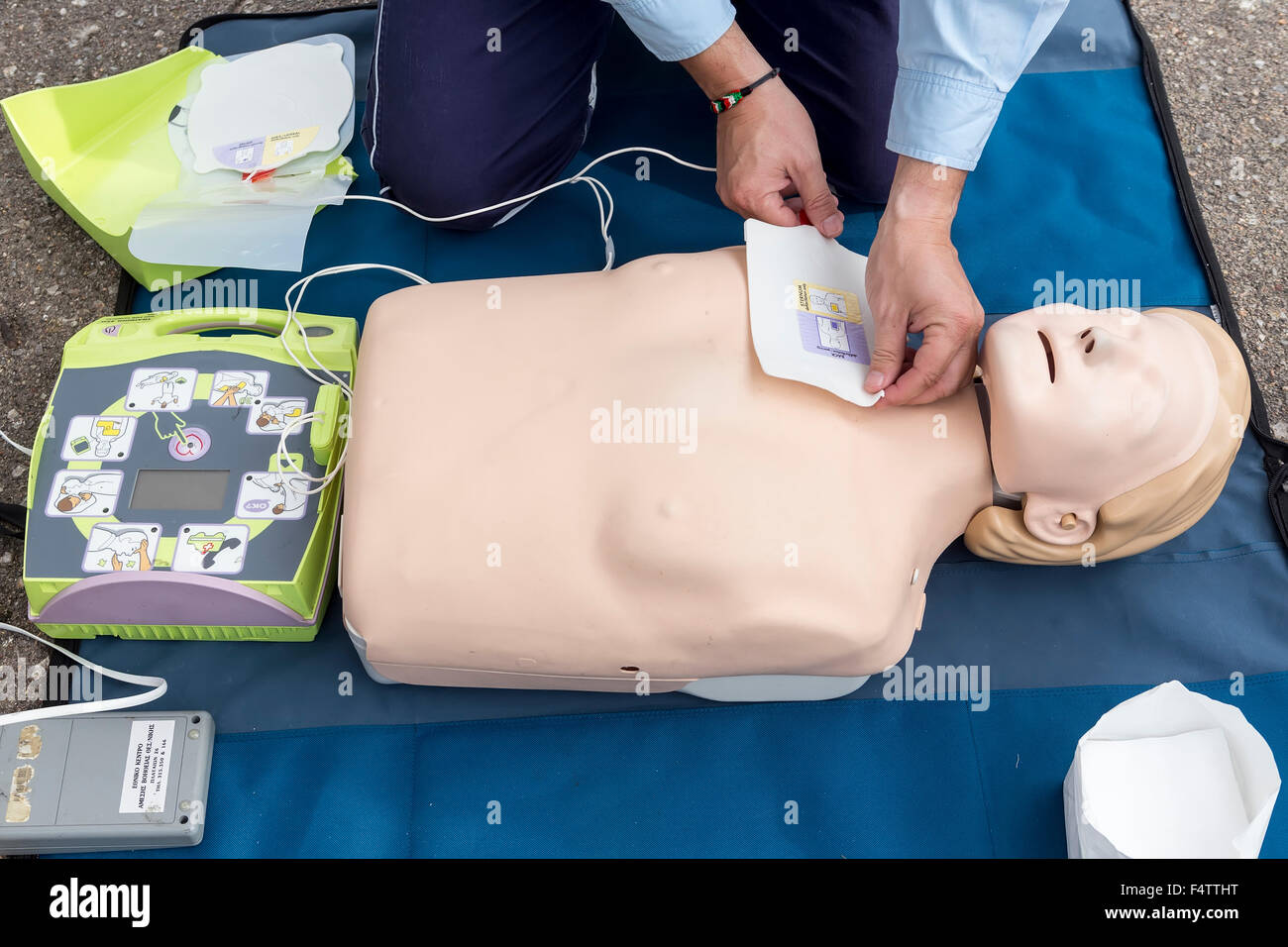 Thessaloniki greece oktober16 2015 the instructor showing cpr stock photo thessaloniki greece oktober16 2015 the instructor showing cpr on training doll free first aid cpr lessons given in the cent xflitez Gallery