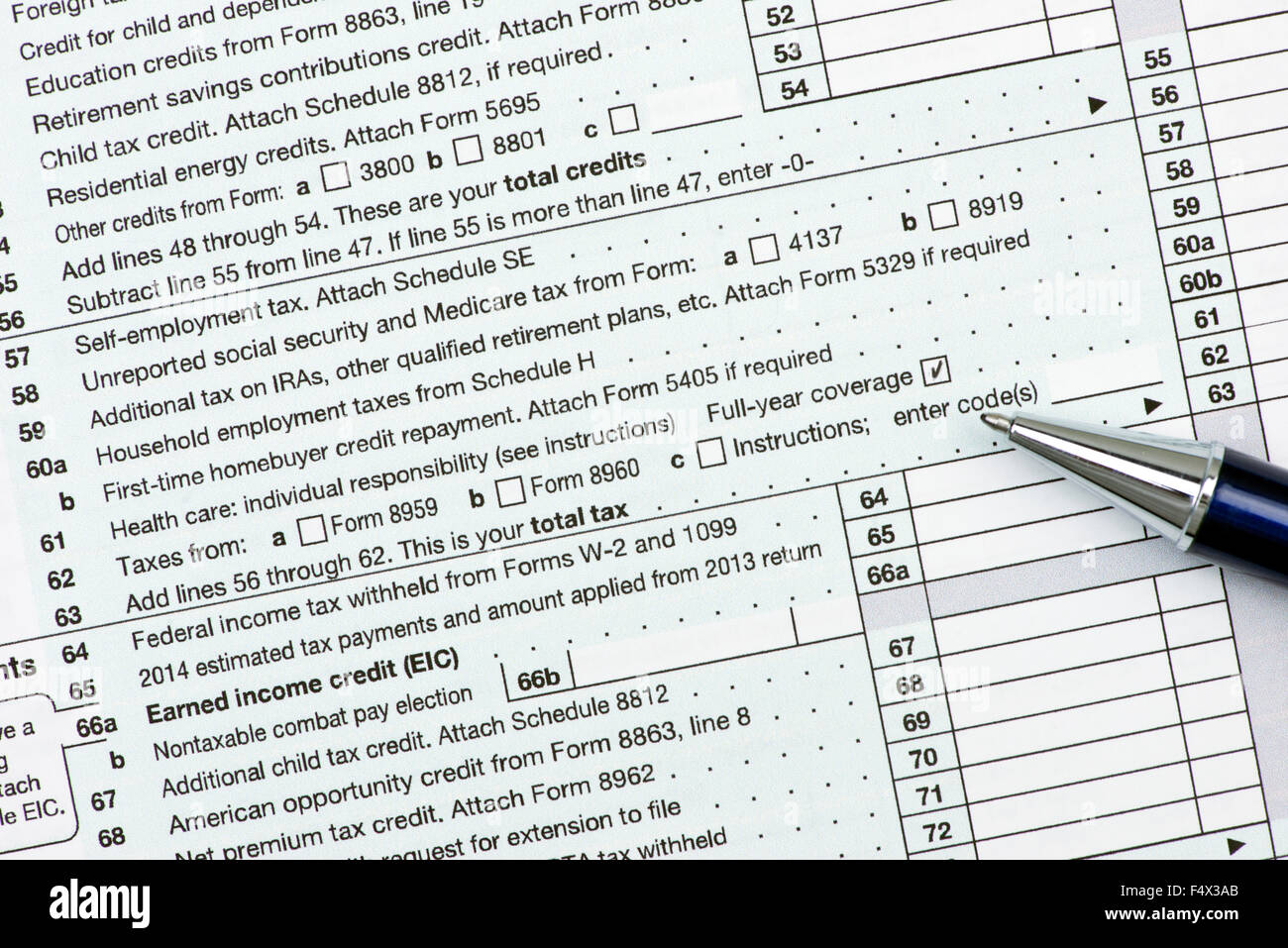 Line 61 on US income tax form 1040 with checked health care ...