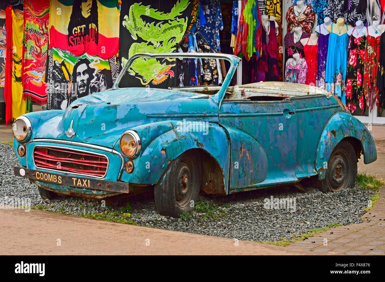 An old car body against a colorful background of ladies wear for ...