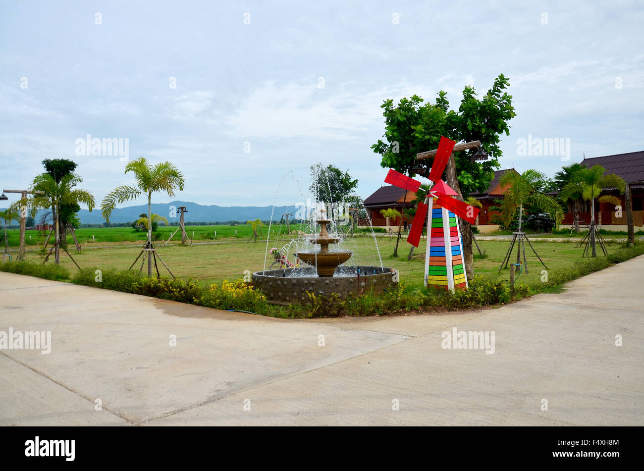 Decoration of gardening Pin wheel or windmill and fountain in garden ...