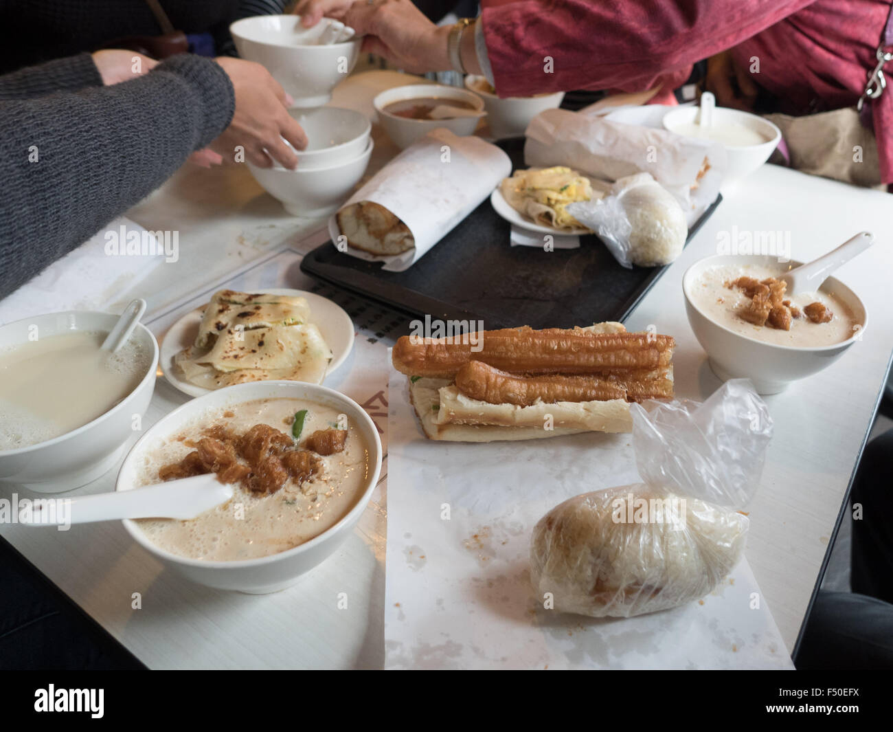 A typical Chinese breakfast of salty soy milk, sweet soy ...