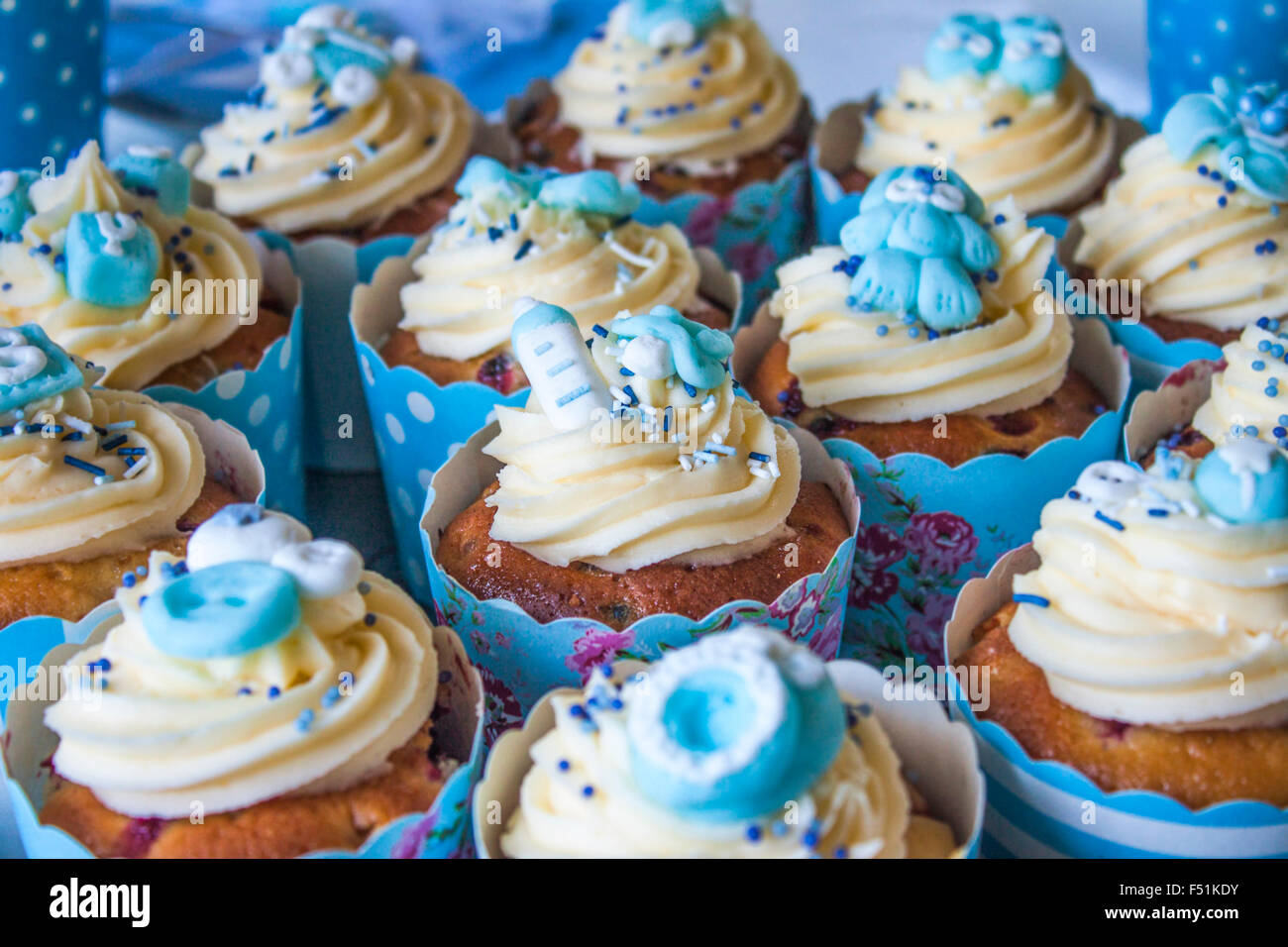 blue baby shower cup cakes with different baby style decorations - Decorating Baby Shower Cupcakes