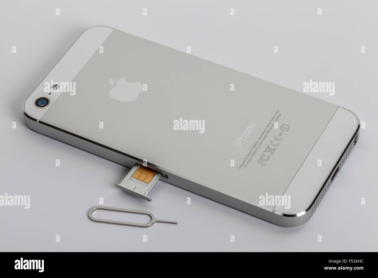apple iphone 5 back nano sim card tray tool stock photo royalty free image 89174216 alamy. Black Bedroom Furniture Sets. Home Design Ideas