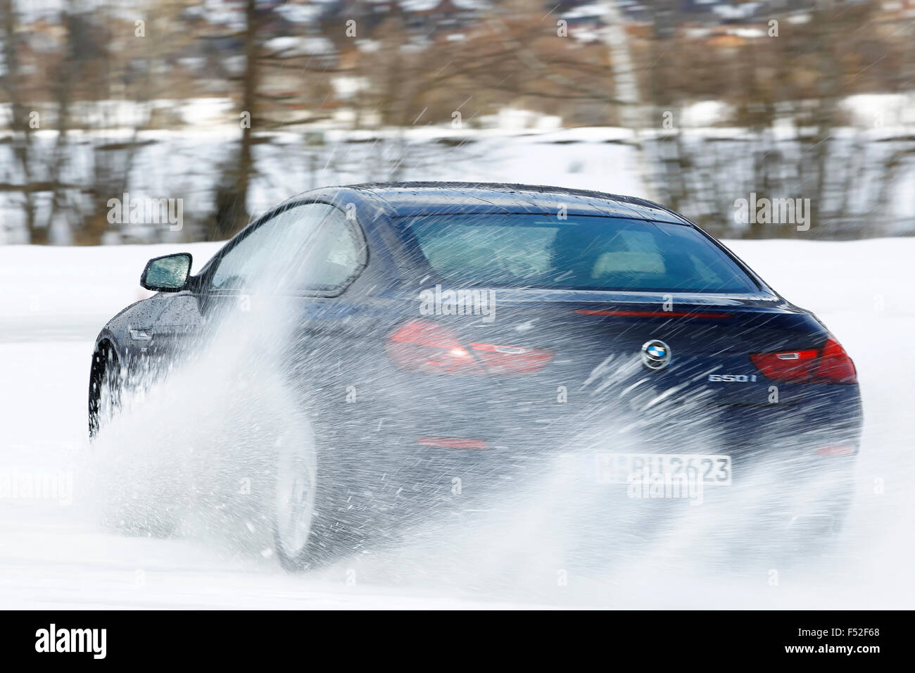 Car bmw 650 i four wheel year of construction in 2012 on ice and snow in drift