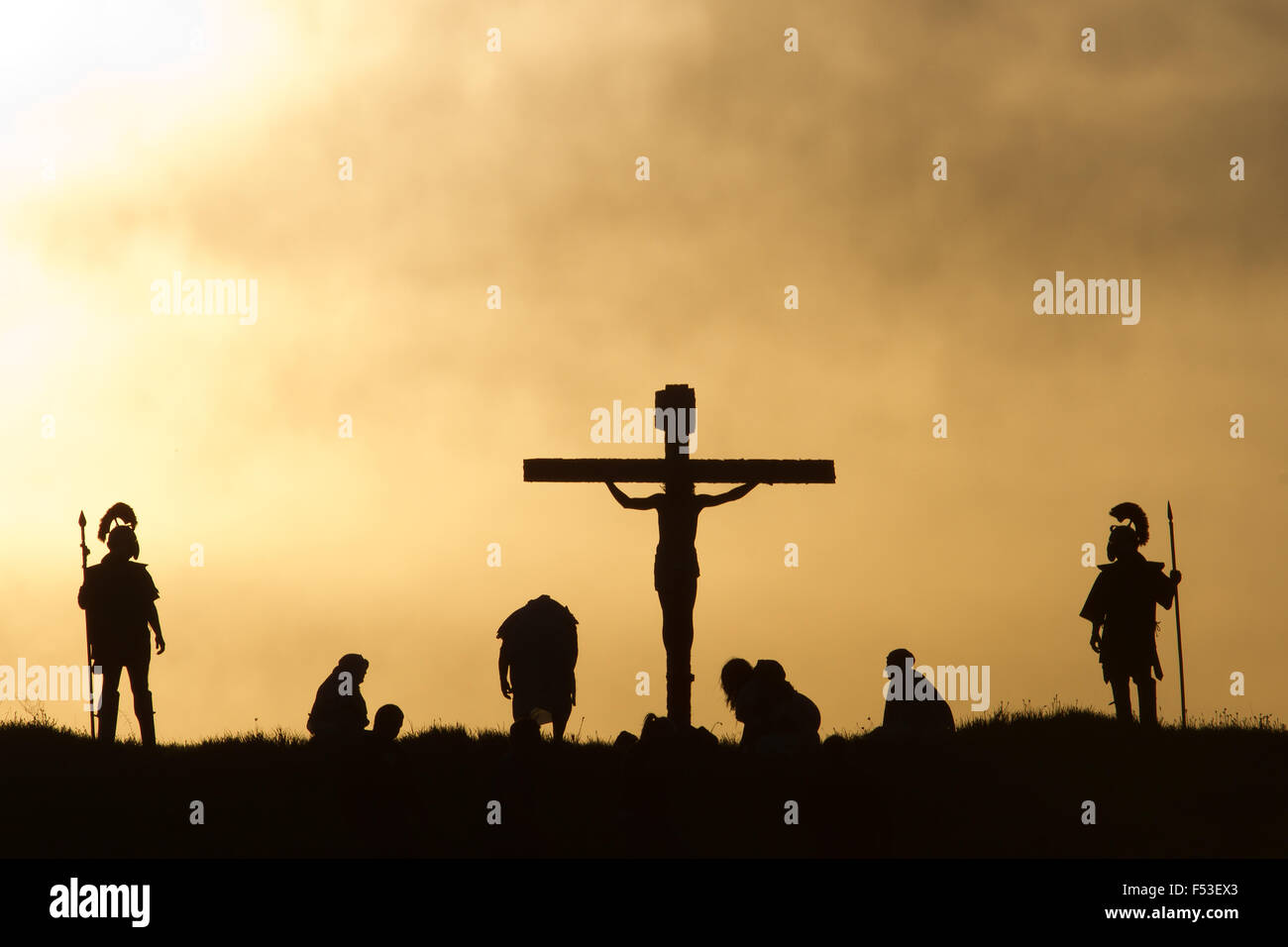 Silhouette of the holy cross on background of storm clouds stock - Crucifixion Scene With Actors In Silhouette Stock Image