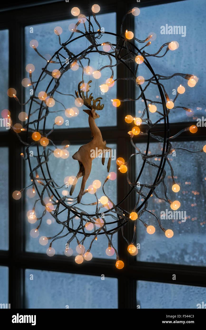 christmas lights hanging on window indoors iceland stock photo royalty free image 89216403. Black Bedroom Furniture Sets. Home Design Ideas