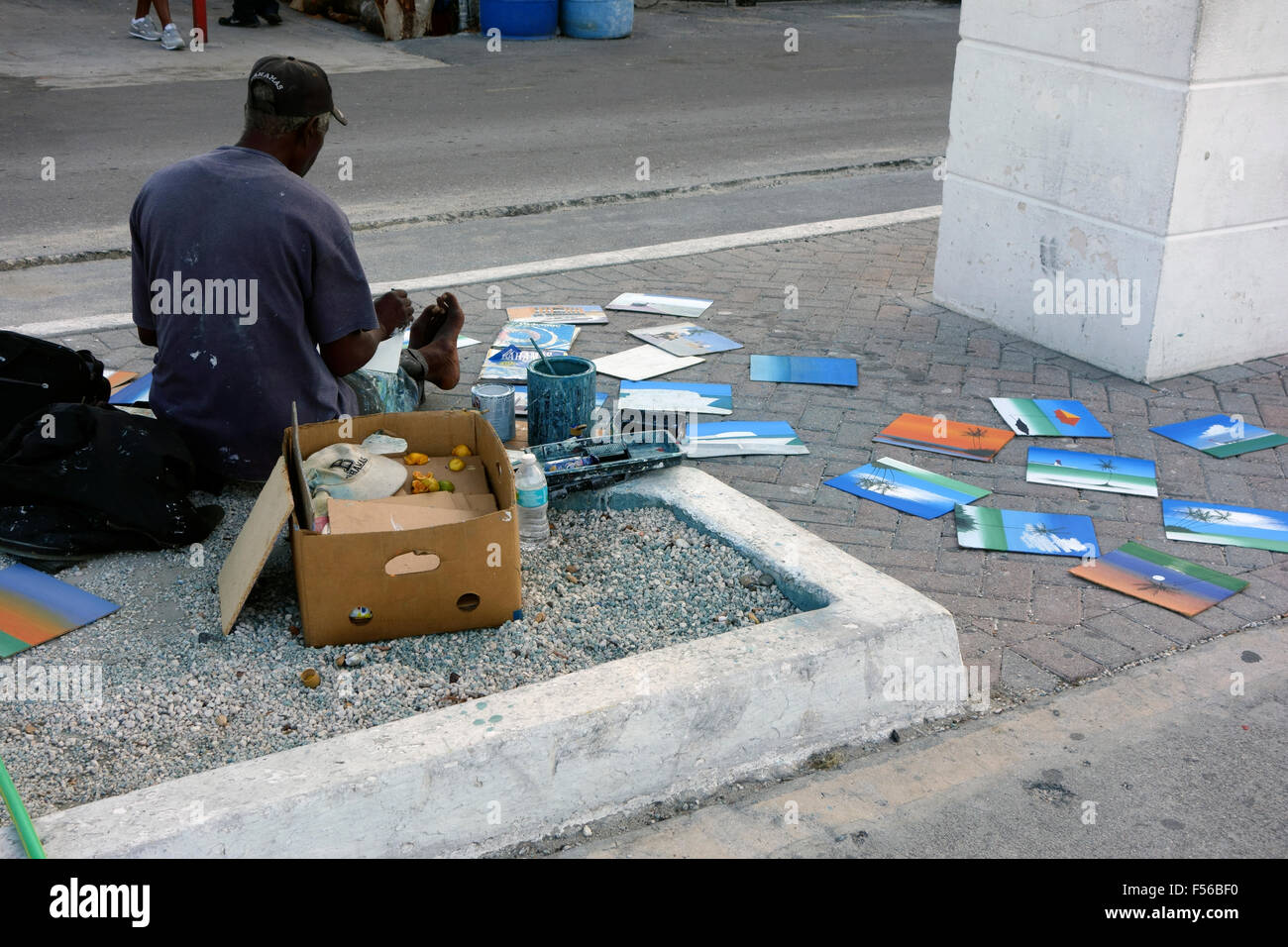 street artist selling his paintings on the street near
