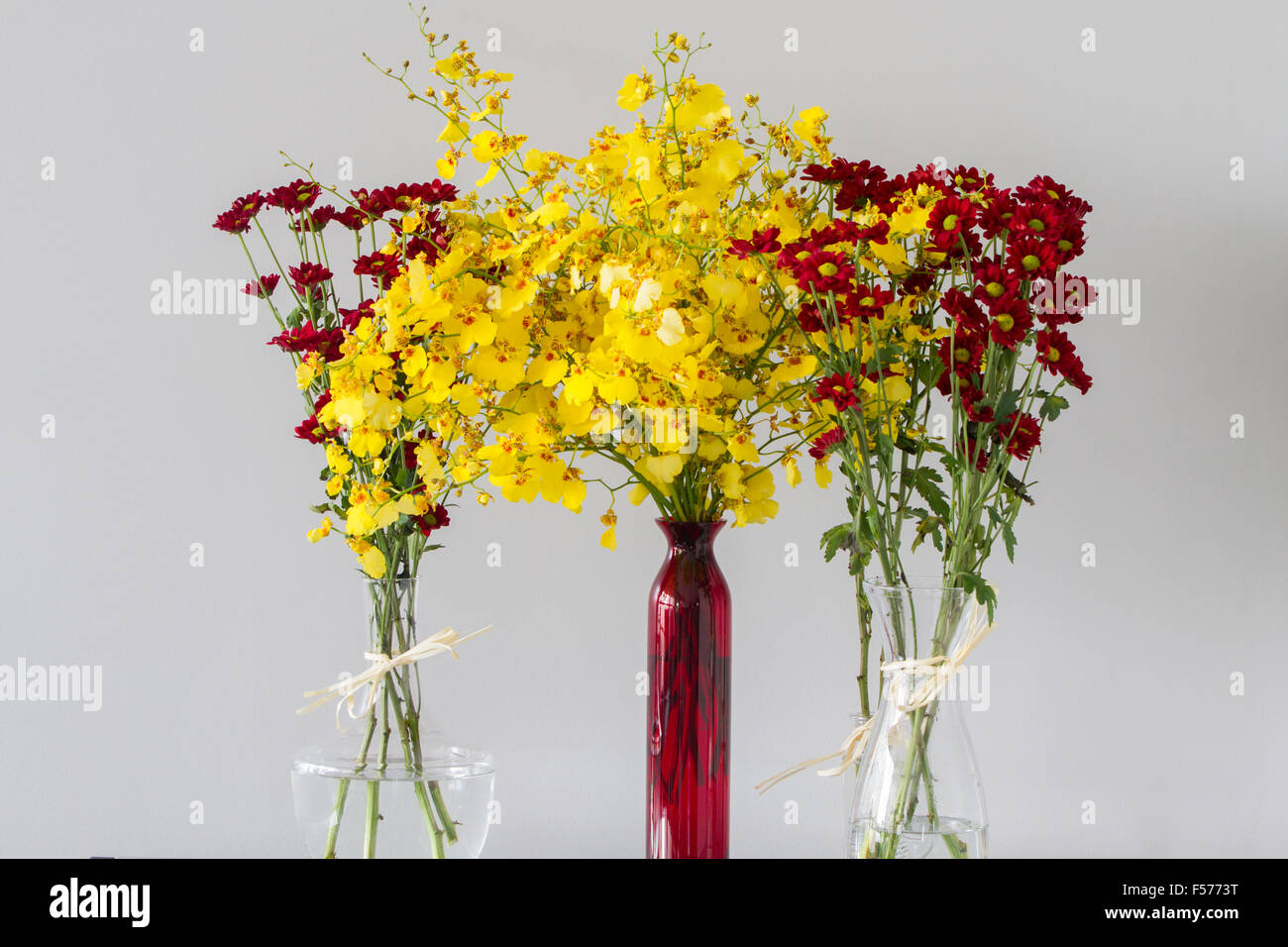 Red chrysanthemum flowers with yellow centres in transparent glass red chrysanthemum flowers with yellow centres in transparent glass vases of different shapes and yellow flowers in red vase over reviewsmspy