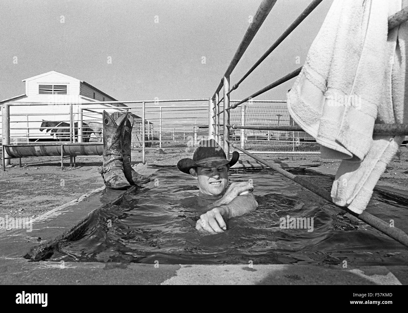 A cowboy on the Macy Ranch in West Texas takes an afternoon bath ...