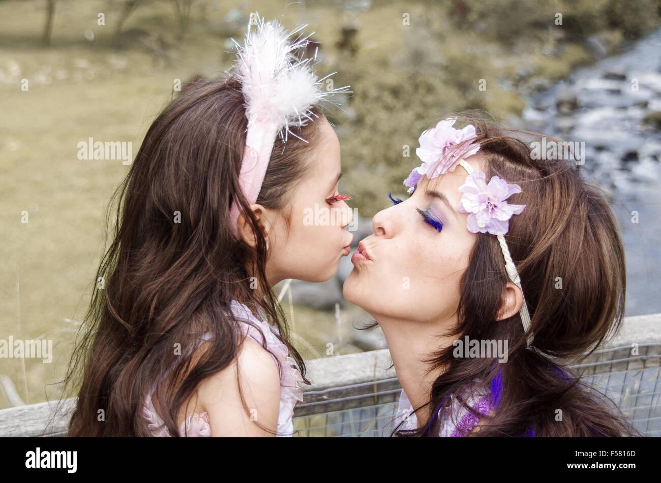 girls kissing moms