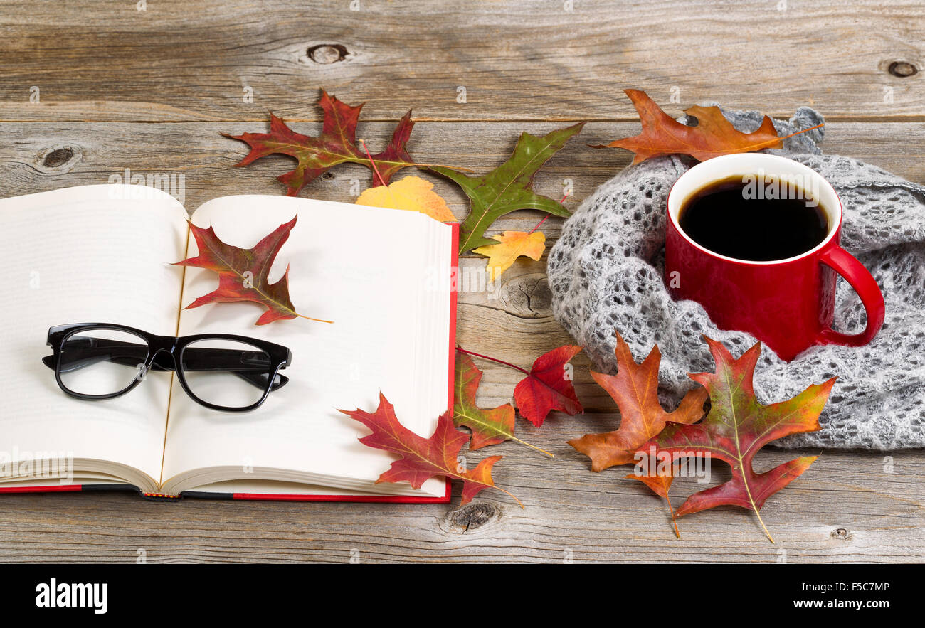 Coffee, autumn leaves, book, reading glasses and gray ...
