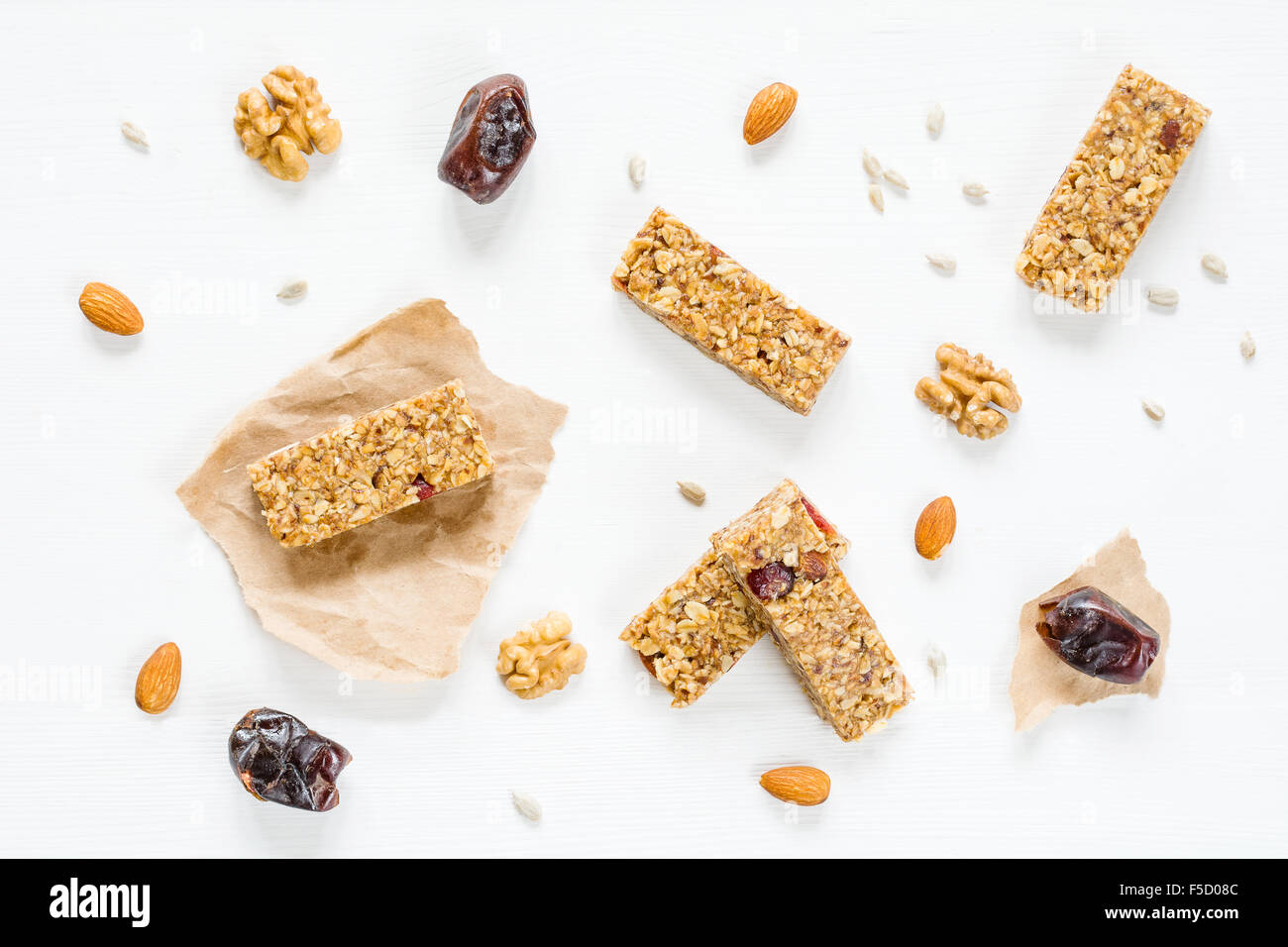 Granola Bar Or Energy Bar With Oats, Dates And Nuts On White Wooden  Background, Top View. Snack For Yoga, Fitness Or Sports