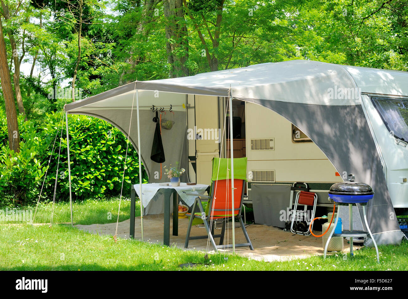 Caravan with a awning at a c& site & Caravan with a awning at a camp site Stock Photo Royalty Free ...