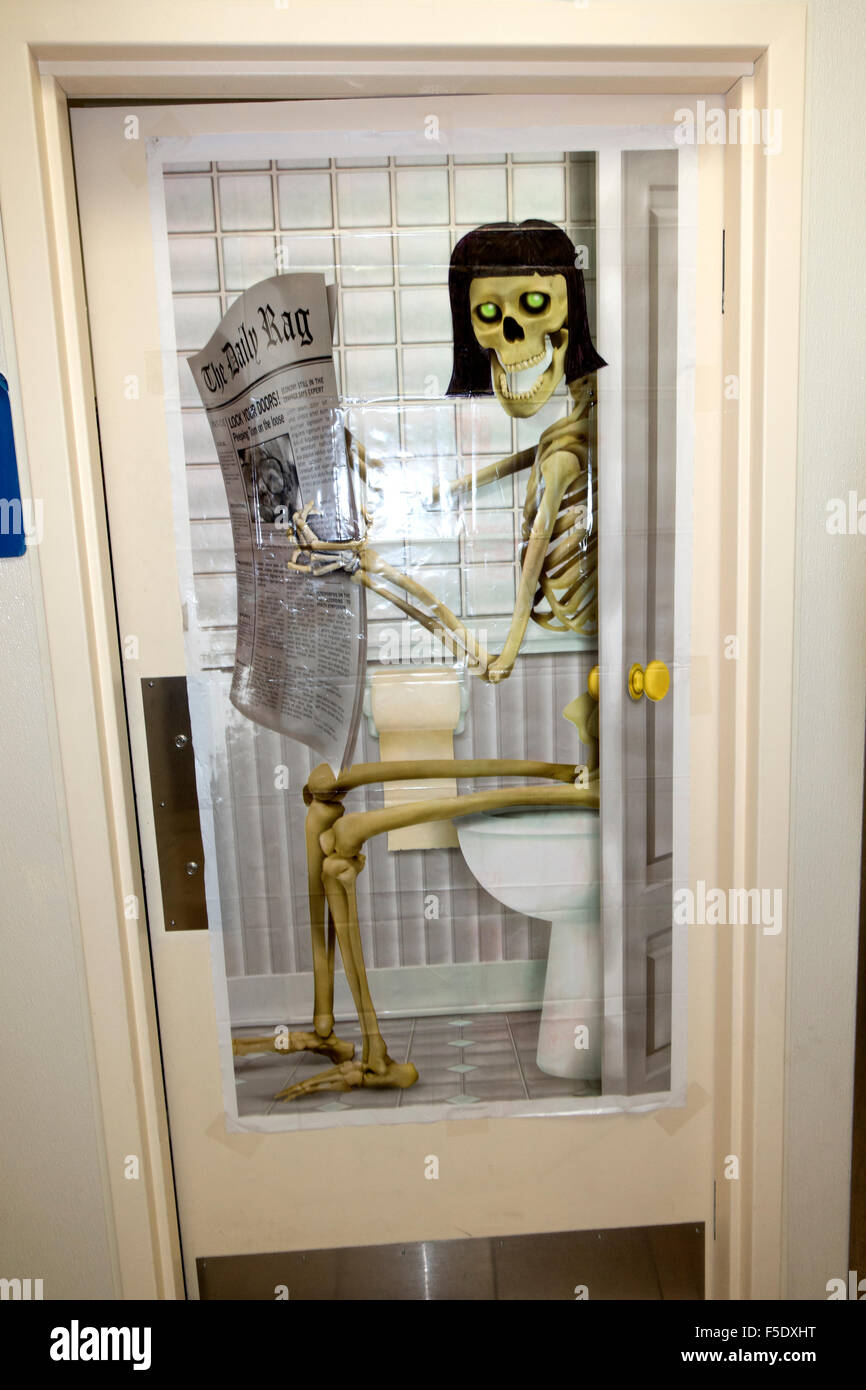 Poster Of A Woman Skeleton Sitting On Toilet Reading