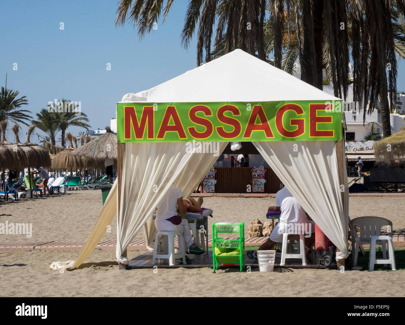 Massage tent with clients on the beach in Marbella Spain & Massage tent with clients on the beach in Marbella Spain Stock ...