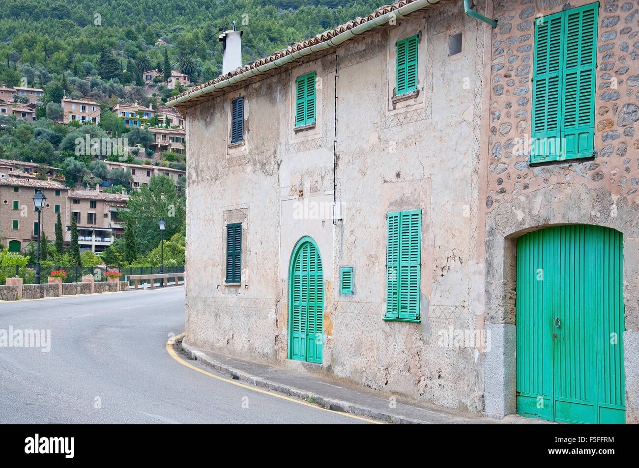 Curvy Road Around A Building With Green Window Shutters On An ...