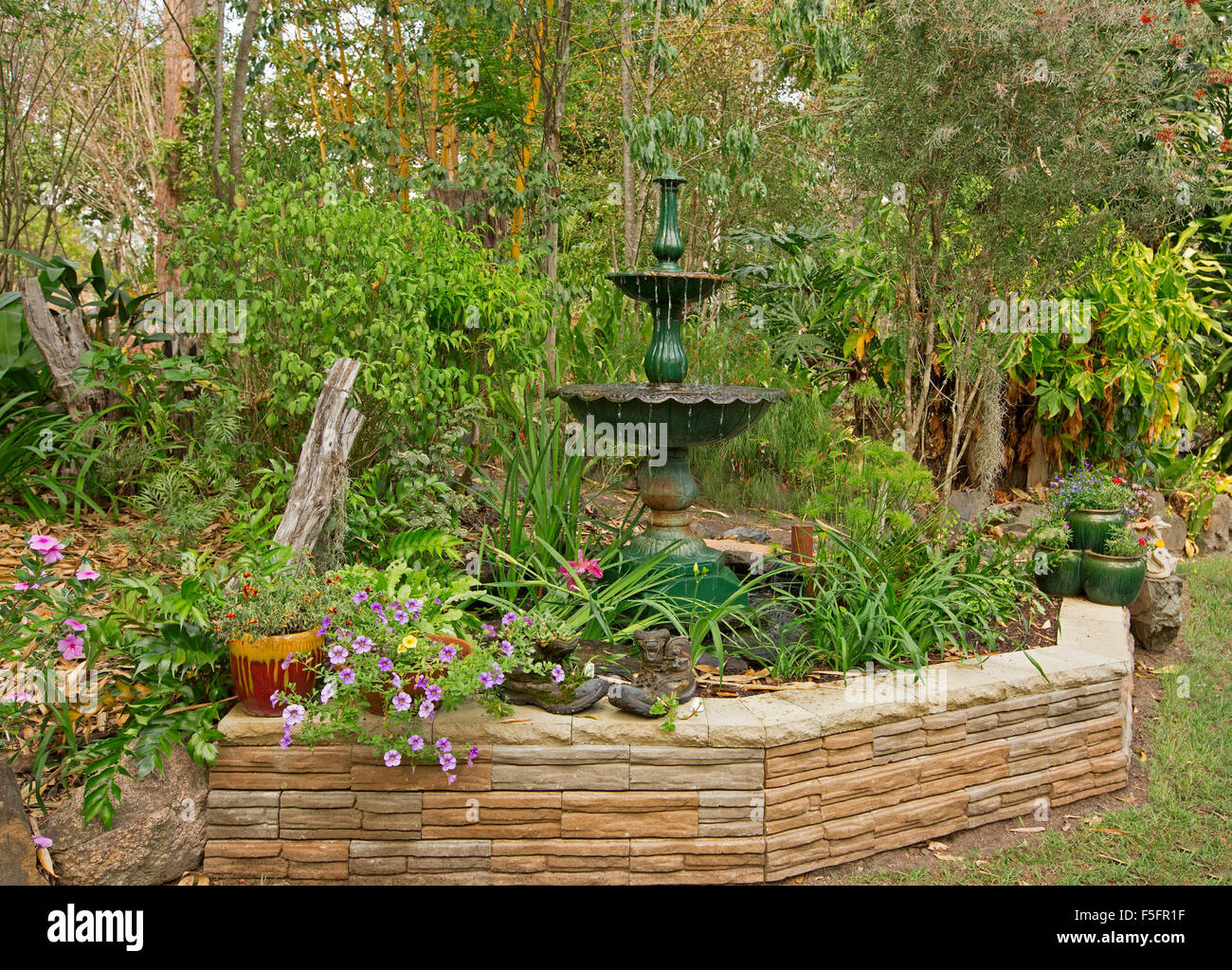 Decorative Landscape Plants : Decorative garden feature with low stone wall ornate