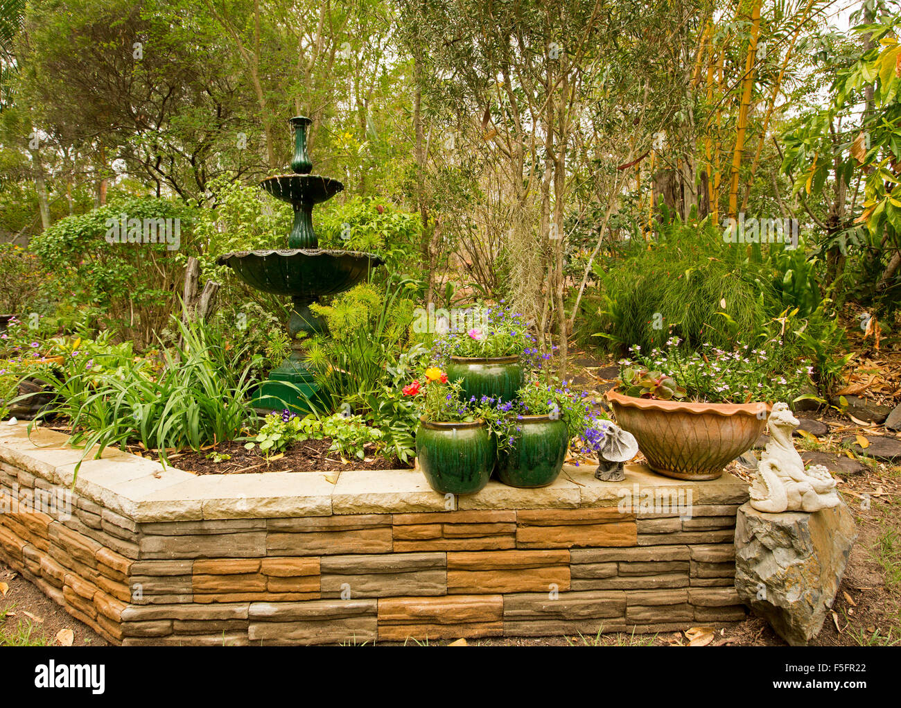 Decorative garden feature with low stone wall ornate for Ornamental garden features