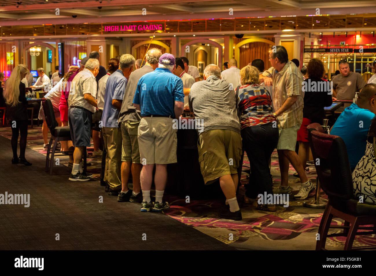 patrons at gaming tables stock image - Gaming Tables