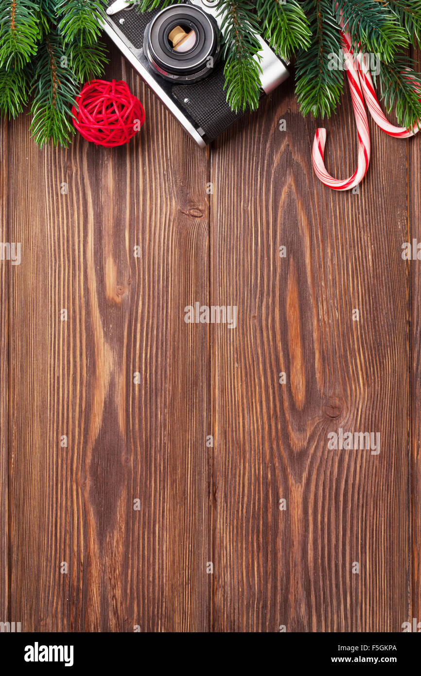 Christmas Tree Branch, Camera And Candy Cane On Wooden Table. Top View With  Copy Space