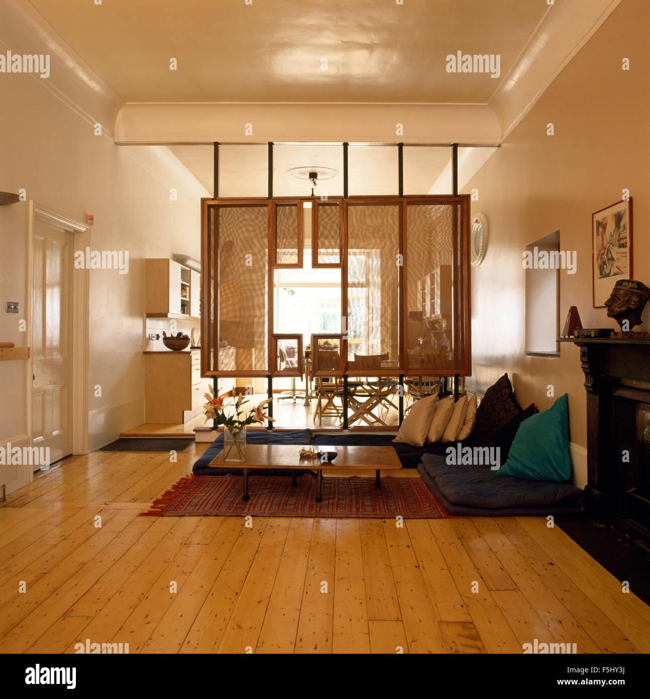 Studio Apartment Open Plan wooden flooring and rattan screen in seventies open plan studio