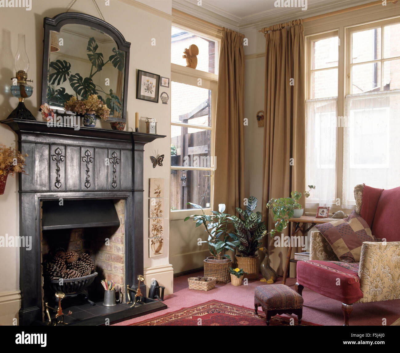 Original Cast Iron Edwardian Fireplace In A Seventies Townhouse Living Room With Vintage Wing Chair