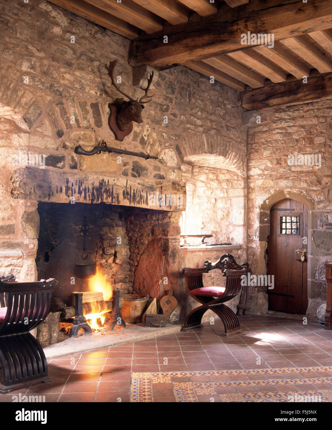 Lighted Fire In Fireplace In A Medieval Style Hall In